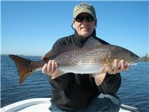 Cold water, low tide flats fishing for redfish and speckled trout.
